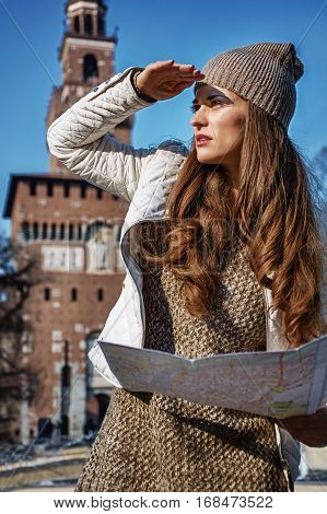 Traveller Woman In Milan With Map Looking Into The Distance