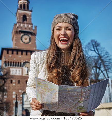 Happy Trendy Tourist Woman In Milan, Italy With Map
