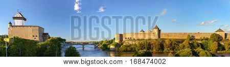 Narva Herman castle and Ivangorod fortress stand on banks of Narva river. Medieval fortifications on Estonian-Russian state border. Hermanni linnus Estonia European Union Russia