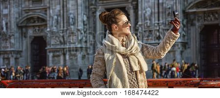 Woman In Front Of Duomo, Milan With Digital Camera Taking Photo