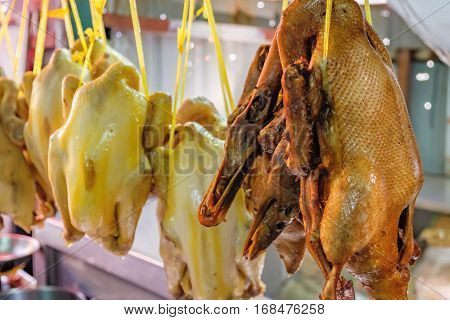 Peking duck roasted for sale at street market of Chinatown district in Bangkok, Thailand. Traditional chinese cuisine. Selective focus