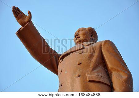 SHENYANG, CHINA - JUL. 26, 2012: Chairman Mao (Mao Zedong or Mao Tse-tung) Statue in Zhongshan Square in downtown Shenyang, Liaoning Province, China.
