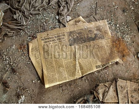 PRIPYAT, UKRAINE - OCTOBER 24, 2016: Old newspaper in the ghost town Pripyat in the Chernobyl Exclusion Zone which was established after the nuclear disaster in 1986