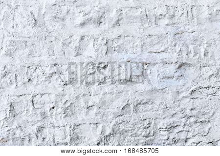 Old clay bricks.Vintage brick wall with white plaster texture or background