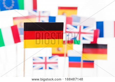 Small paper German flag against European Union member-states flags