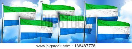 Sierra Leone flags, 3D rendering, on a cloud background