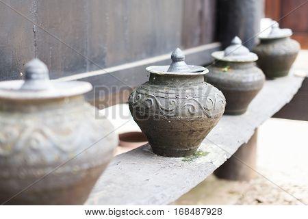Earthenware ,Old handmade Pottery on the wood