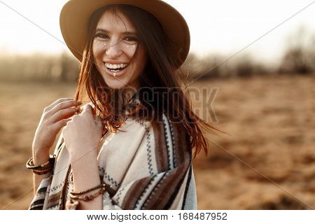 Beautiful Boho Woman Hipster, Smiling, Wearing Hat And Poncho At Sunset In Mountains, True Emotions,