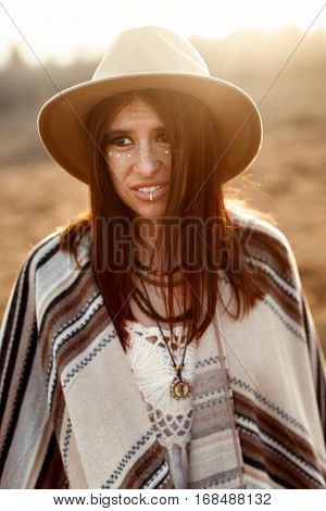 Beautiful Boho Woman Hipster Portrait, Wearing Hat And Poncho,  At Sunset In Mountains,  Funny  Look