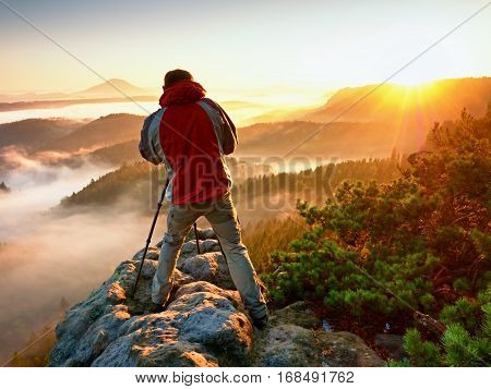 Happy Photo Enthusiast  Enjoy  Photography Of  Fall Daybreak In Nature On Cliff