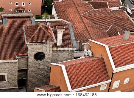 Many red tile Roofs close. Old Budva town