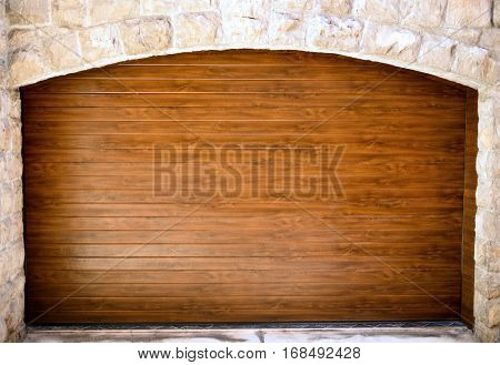 Wooden entrance in stone wall door, may be used as background