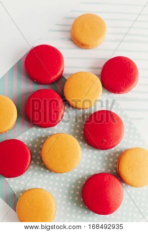 Stylish Red And Yellow Macaroons Stacked On Modern Craft Paper, Creative View. Space For Text. Cater