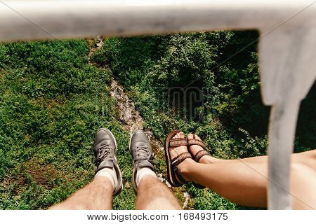 Stylish Hipster Couple Legs On Chairlift  In Summer Mountains, Travel Together Concept, Space For Te