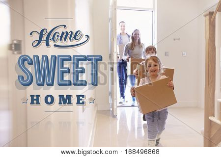 Family Carrying Boxes Into New Home Sweet Home