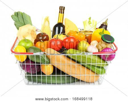 Fresh vegetables and foodstuff in shopping basket on white background