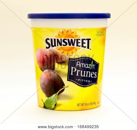 New York, January 25, 2017: A bucket of Sunsweet pitted prunes stands against white background.