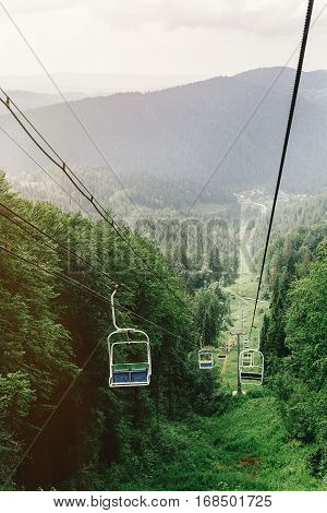 Cable Hoist Chair Lift Among Woods View To Top Of Mountain, Summer Travel Explore Concept, Amazing S