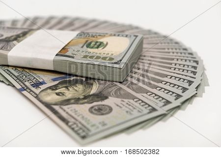 Stack of money in US dollars in cash in hundred dollar bills