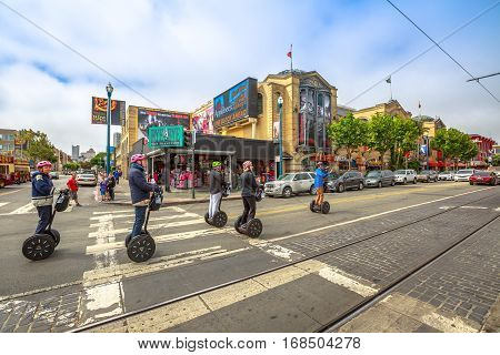 San Francisco, California, United States - August 14, 2016: popular Fisherman's Wharf, waterfront and Northbeach Segway Tour on Jefferson and Mason st corner near McDonald's. San Francisco street view
