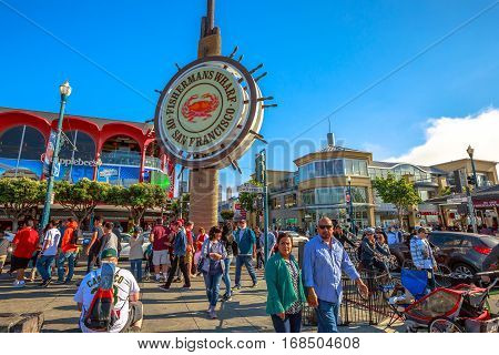 San Francisco, California, United States - August 14, 2016: tourists at Fisherman's Wharf of San Francisco on Jefferson road. The Fisherman's Wharf is a neighborhood and famous waterfront in SF.