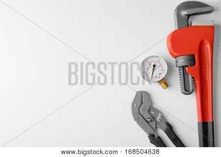 Plumber tools with red wrench isolated on white