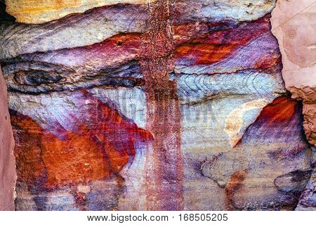 Red Blue Rock Abstract Petra Jordan Built by the Nabataens in 200 BC to 400 AD. Rose Red canyon walls create many abstracts close up. Inside the Tombs the rose red can become blood red. Reds are created by magnesium in sandstone.