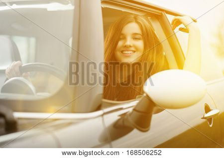 Young beuatiful woman driving a car