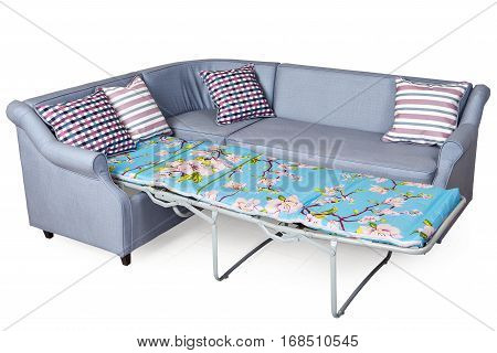 Light gray corner fold-out upholstered in fabric sofa bed isolated on white background with clipping path saved.