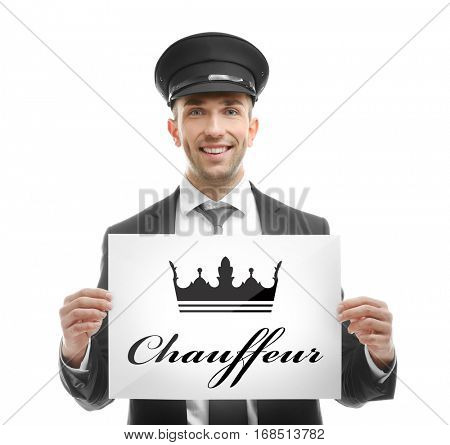 Young man standing with banner CHAUFFEUR on white background