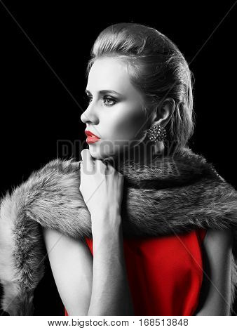 Young woman with color accent in makeup and fashion look on black background