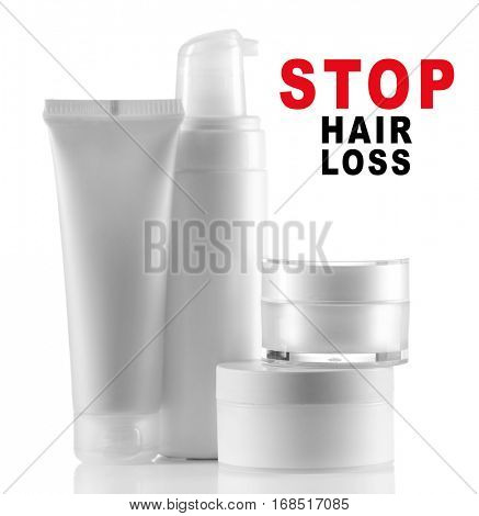 Text STOP HAIR LOSS and set of cosmetic products on white background