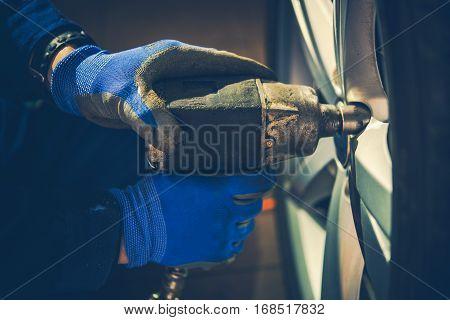 Seasonal Car Tires Replacement Closeup Photo. Car Wheels Maintenance. Auto Service.