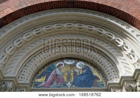 MARIBOR, SLOVENIA - APRIL 03: Annunciation, lunette above the entrance to the Franciscan Church of St.. Mary Mother of Mercy in Maribor, Slovenia on April 03, 2016.