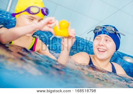 Happy Children in the Jacuzzi. Two Caucasian Girls Having Fun in the the Jacuzzi. Children Recreation Concept.