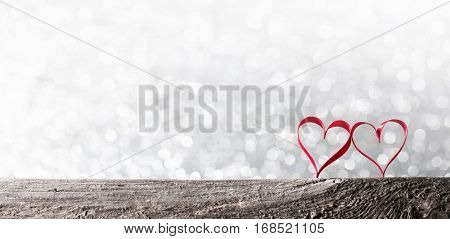 Two red ribbon hearts on wooden backround, Valentine day concept