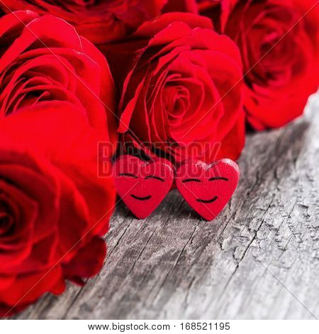 Rose and happy hearts on old wooden background, Valentines day