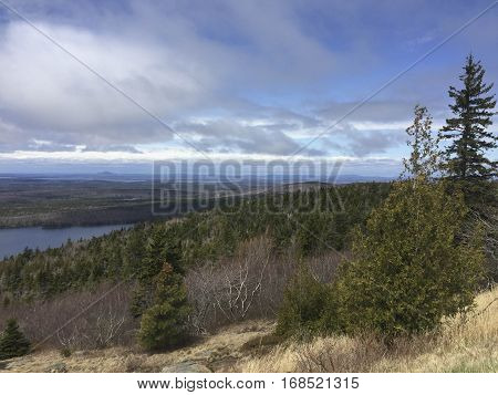 Beautiful blue skies during early Spring on top of Cadillac Mountain in Bar Harbor Maine located in the Acadia National Park.