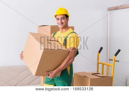 Transportation worker delivering boxes to house