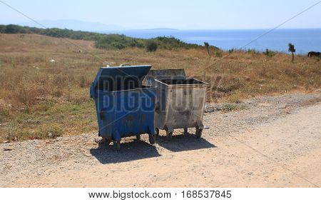two garbage tank on the sea shore.