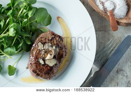 Steak And Truffles Dish Beside Bowl Of Truffle Salt