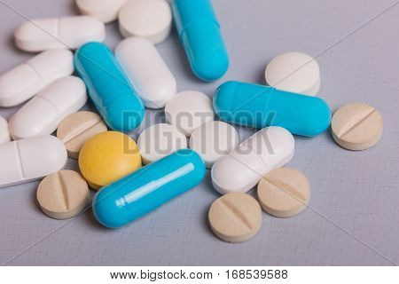 diferent Tablets pills capsule heap mix therapy drugs