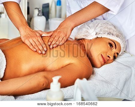 Massage woman therapist making manual therapy back. Hands of masseuse close up. Treatment of spinal injuries 40 old client in spa salon.