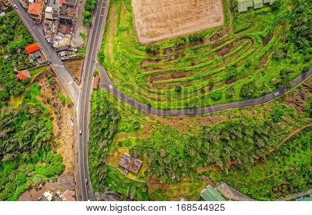 Aerial View Over Small Green Fields In Banos De Agua Santa Tungurahua Province In The Daylight South America