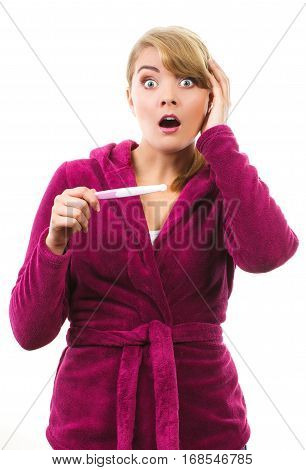 Unhappy And Worried Woman Holding Pregnancy Test With Positive Result