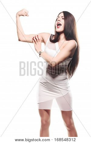 brunette girl in glamour outfit showing her muscles