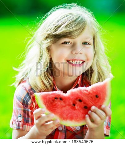 happy child with watermelon outdoor on a summer day