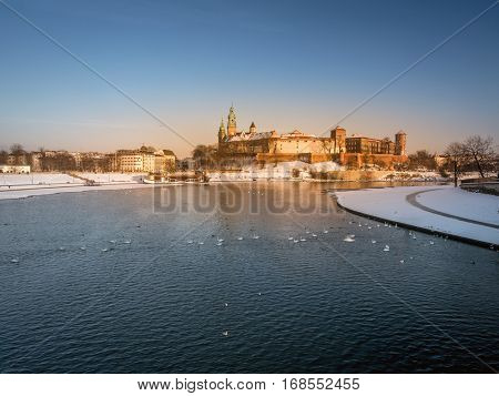 Royal Wawel Castle reflecting in the Vistula river, Krakow - PolandRoyal Wawel Castle with the Vistula river in winter time, Krakow - Poland