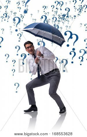 Uncertainty concept with businessman and question marks