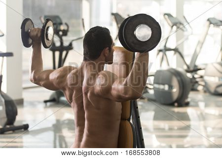 Shoulders Exercise With Dumbbells In A Gym